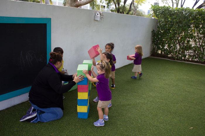 children using building blocks outside